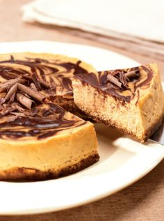 Gingersnap Crusted Pumpkin Chocolate Cheesecake | This cheesecake recipe would be perfect for Thanksgiving! It just looks like such a delicious pumpkin dessert recipe!