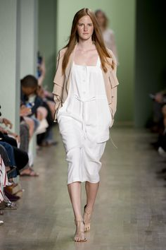 Tibi Spring 2016: A relaxed silk trench coat and white button-front midi dress with a drawstring waist.