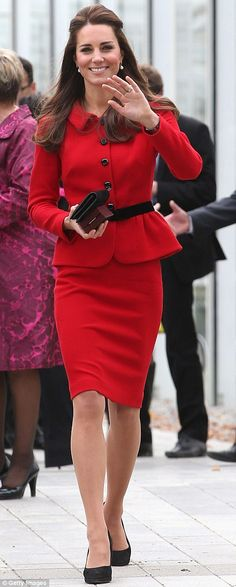 Ravishing in red: The Duchess Of Cambridge wore a recycled peplum-style scarlet suit for her day in Christchurch