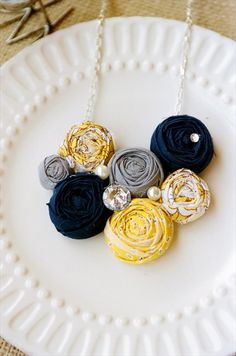 You know abbe thad be really cute with a navy dress if that was your color. just saying  Yellow and Gray Statement Necklace Emmaline Bride | The Wedding Guide for the Handmade Bride -- see more at LuxeFinds.com