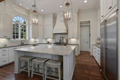 white-kitchen-with-marble-counters-large-dining-island