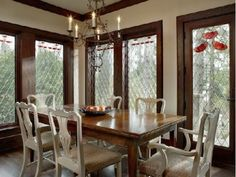 Painted chairs with stained table. Dining Room by Buckingham Interiors