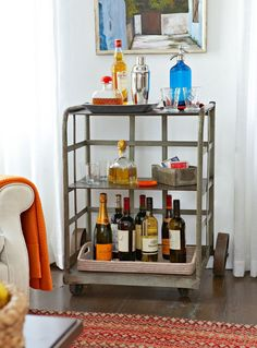 Bar carts serve as stylish yet hardworking hubs for entertaining. Learn how to style your beverage station with these beautiful bar cart ideas. #barcart #barcartstyling #barcartideas #barcartdecor #bhg Bar Cart Styling, Bar Cart Decor, Wine Station, Brass Bar Cart, Rolling Bar Cart, Outdoor Bar Cart, Cane Back Chairs, Vintage Bar Carts, Black Table Lamps