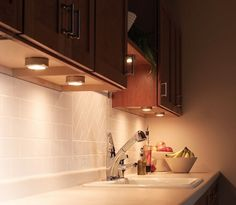 Title: Portable Under Cabinet lighting  Def: These lights underneath the cabinet are used for task lighting. They can be moved and replaced easily in different spots under cabinets.