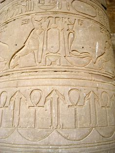 Decorative frieze on a column on the western colonnade of the Court of Offerings. It depicts two royal symbols, a falcon-headed lion and a cobra, while beneath are repeating images of the sacred ankh,...