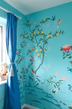 A beautiful wall muralfor a beautiful baby girl. Hand-painted directly onto four walls, a paradise of flowering trees, bamboo and colourful birds provides a stunning environment for a baby. This mural design was inspired by 18th Century chinoiserie wallpapers, which adorned the walls of European ari