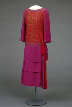 "Afternoon dress, 1923-24, at the National Museum of Art, Architecture and Design. According to the book ""Style and Splendor: The Wardrobe of Queen Maud of Norway 1896-1938,"" Queen Maud may have worn this ""violet and tomato-red"" dress on Midsummer Night's Eve in 1924 and on her birthday in the same year (pg. 51)."