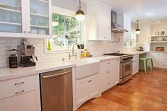 When designing this kitchen in Piedmont, our client opted for a clean, open look that combines white cabinets and white marble countertops against terracotta colored floor tiles. The finishes complete the look of this classic yet contemporary remodel. www.draftingcafe.com