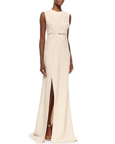 Neiman Marcus: This is a white Elie Saab sleeveless gown with embellishments on the bodice, cinched in waist, and a slit.  I like the simple silhouette with the embellishments for a glam look and the slit for a sexy look.