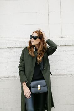 Hunter green coat.