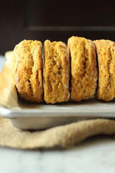 Soft and flaky pumpkin buttermilk biscuits. Slather them in fresh pumpkin butter and serve warm for Thanksgiving, or anytime!