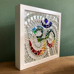 Framed rainbow glass Ohm mosaic | Etsy Rainbow Glass, Mosaics, Frame, Etsy, Home Decor, Picture Frame, Decoration Home, Room Decor, Mosaic