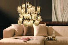 Clusters of crystal rock glass tumble in falling cascades.; Bahir- Custom Lighting and Decor
