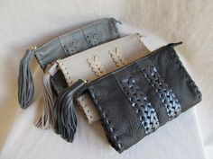 Small sumptuous leather bag. Can be used as a small clutch or just a small bag to store things in. Hand laced detail and leather tassel.