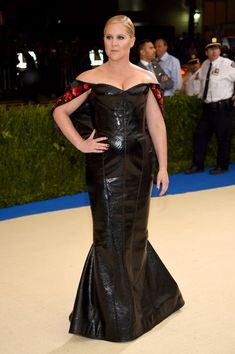 Met Gala 2017 Celebrity Red Carpet Outfits: The 2017 Met Gala red carpet is officially happening, and we would never dream of letting you miss a single standout look. We'll be here all night gathering the most out-there and most beautiful looks of the night. -- Amy Schumer, MetGala 2017, in a black leather dress with red roses on the sleeves.   Coveteur.com