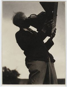 by Paul Strand Photograph of Alfred Stieglitz looking into a camera, 1929