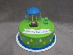"""""""Sprinkles"""" themed baby shower with hand crafted umbrella, frog and football"""