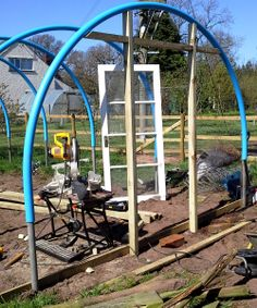 Door frame going up & Putting the door frame and window in place | polytunnel ideas ...