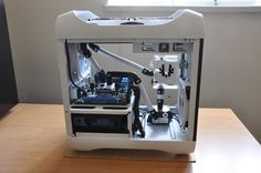 Minimal computer water cooling design. So beautiful... White and black with hints of blue, insane.