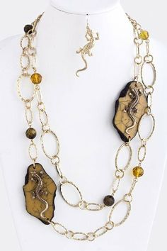 """Lizard On Topaz Stone Gold Chain Link Layered Necklace - Topaz Stone With Lizard Gold Chain Link Necklace StarShine Jewelry. $26.00. Lobster claw clasp with 3"""" extender. Lizard on stone chain necklace. Lead and nickel compliant. Length approx 28"""""""