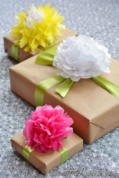 Gift wrapping with tissue paper flowers is a simple way to wrap gifts, but it looks so beautiful!  This would be perfect for Mother's Day!
