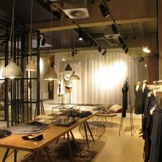 Esprit Lighthouse store by Reich und Wamser...I would make a studio out of it!  Love the lightening.