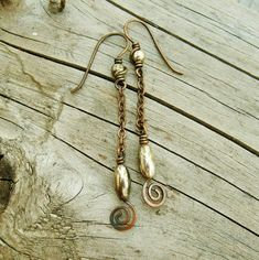 Antiqued copper and silver wire wrapped swirl by BearRunOriginals