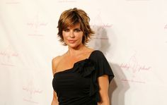 """Lisa Rinna is known both for her role on """"Days of Our Lives"""" and for her fabulous short hair.  Lisa and her stylist Matthew Shields tell you how to get that sassy, disheveled-chic look she's so famous for. (Photo: Amy Sussman/Getty Images Entertainment/Getty Images)"""