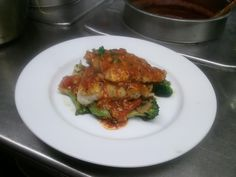 Grilled Cod Filet over a bed of broccoli, artichokes, red pepper, and mushroom with a tomato lemon garlic sauce