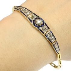 Art Deco diamond blue sapphire articulated bracelet. A gorgeous Art Deco articulated bracelet set with 2.10 carat diamonds and blue sapphires, 18kt yellow gold and platinum, crafted circa 1920's. (hva)