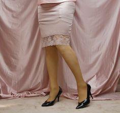 Beige Half Slip Sheer Stockings With Visible Garter Bumps Underneath and Black High Heels