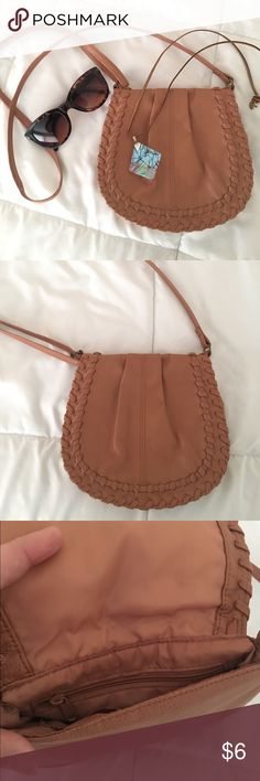 Fesitval Shoulder/Crossbody Bag Very cute brown bag. Adjustable strap; can be worn over the shoulder or crossbody. Carried once, excellent condition. I find it can hold a small wallet, keys, makeup, etc. Would be wonderful for travel or festival season! Magnetic closure with one interior zippered and one open pocket. Forever 21 Bags