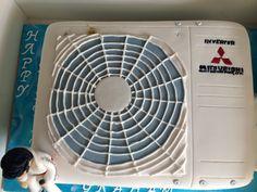 Mitsubishi air conditioner cake with fondant Elvis topper