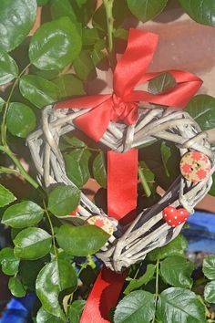 Wicker and ribbon heart hanging decoration on Cthulhu Cat Cult. Ribbon Decorations, Wicker Hearts, Heart Wreath, Cthulhu, Red Ribbon, Custom Items, Creepy, Gift Wrapping, Valentines
