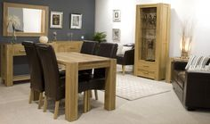 Emphasizing the Design of Your House by Utilizing Modern Hallway Furniture: Captivating Interior Design Dining Room With Oak Dining Table And Dark Leather High Back Dining Chairs Also Loveseat And Narrow Console Table For Hallway ~ bbdesignsny.com Hallway Inspiration