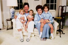 I love this picture of Ozzy & Sharon Osbourne, with their babies (: