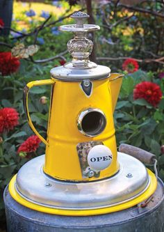 Old Perk Birdhouse ~ Birdhouse made from a yellow porcelain enamel pitcher. Love the Open doorknob!  #wm