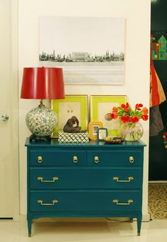 "I follow this blog, ""the little green notebook"" and love her vintage modern style. Love the peacock blue dresser. she (jenny) painted it and replaced hardware. Notice the old photo of the Arizona temple on the wall above the dresser."