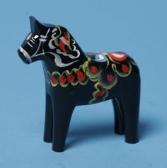 "Carved Wooden Dala Horse (Dalahäst) - Black 3"" Tall.  Nils Olsson Dala Horses  (Dalahäst) - Since 1928 - The Premier Dala Horse Workshop - Swedish National Symbol - The Scandinavian Folk Art - Handcrafted in Nusnäs, Dalarna, Sweden. Visit www.mygrowingtraditions.com for a selection of Nils Olsson carved Dala Horses."