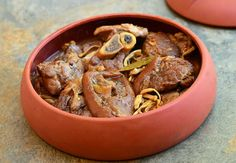 Paksiw na pata is Filipino stew made with pork shanks simmered in vinegar and soy sauce, banana blossoms are added at near end of cooking as well as brown sugar to sweeten the sauce.