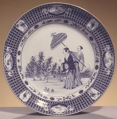 Plate depicting a lady with parasol After a design by Cornelis Pronk (Dutch, Amsterdam 1691–1759 Amsterdam) Date: ca. 1734–37 Culture: Chinese Medium: Hard-paste porcelain painted with cobalt blue under transparent glaze (Jingdezhen ware)