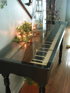 upcycle an old piano keyboard into a table....