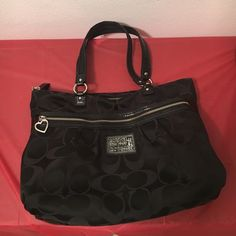 Coach Poppy Black Hobo Purse w/ Signature C's Gently used all black authentic coach poppy hobo bag. Signature C's with heart shaped zipper. Very spacious compartments located on the front on the bag and the inside of the bag Coach Bags Hobos