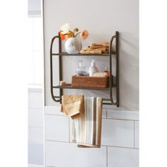 another bathroom shelving idea that performs multiple duties great for small bathrooms again