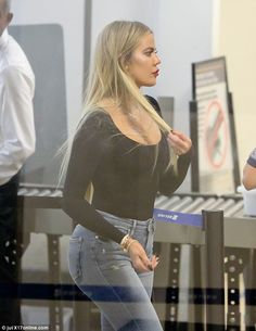 Stunner:Khloe Kardashian put her astoundingly toned figure on display in skintight jeans on Thursday at LAX