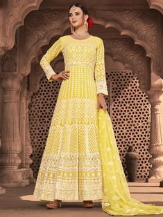 Adorable yellow embroidered gown anarkali for women available at Inddus. This elegant set comprises a viscose georgette anarkali kurta with cotton leggins also paired with net dupatta. Anarkali Tops, Anarkali Lehenga, Indian Anarkali, Anarkali Suits, Pakistani, Long Anarkali, Churidar Suits, Bridal Lehenga, Indian Suits Online