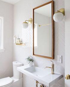 Love the white tiles in the fishbone pattern! ⭐️ so fresh! pic from sarahshermansamuel.com #bathroom #bathroominspiration #tiles #brass