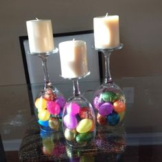 Haa! Wine glasses as candle holders! Fill the bottom with moss and maybe green candles. Could even use the plastic wine glasses if you need many.