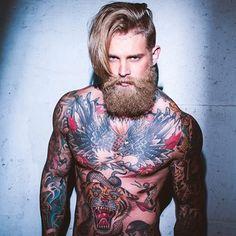 This beautiful tattooed beast man. | 27 Men's Undercuts That Will Awaken You Sexually www.whatstrending.co.za