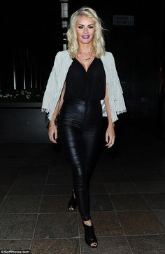 Dressed to impress: The mother-of-one teamed the revealing top with a pair of black skinny leather trousers and a taupe fringe suede jacket